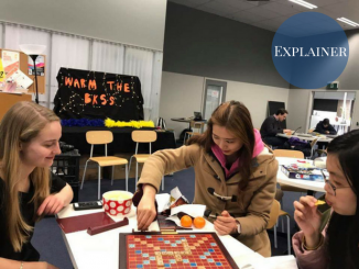 Students playing a board game in the BKSS