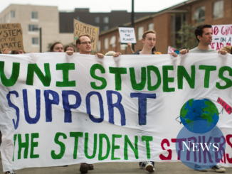 "Students holding a banner that reads ""Uni students support the student strikers"""